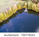 fishing lodge in the corner of... | Shutterstock . vector #730778161