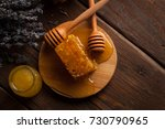 honey dipper and honeycomb with ... | Shutterstock . vector #730790965