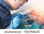 the asian technician repairing... | Shutterstock . vector #730798624