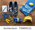 fitness concept with sneakers... | Shutterstock . vector #730800121