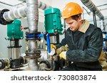 technician plumber of heating... | Shutterstock . vector #730803874