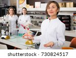 nail technician offering to... | Shutterstock . vector #730824517
