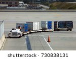 Small photo of Atlanta, Georgia, USA - October 13, 2016: Dolly fleet operator drives vehicle, which pulls dollies for baggage unit load devices at busy Hartsfield-Jackson Airport.