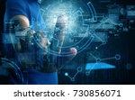 businessman press virtual screen | Shutterstock . vector #730856071
