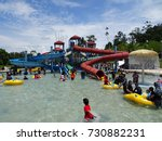 Small photo of AYER KEROH, MALAYSIA -OCTOBER 1, 2017: Visitors enjoy their holiday with kids playing waterpark playground in Melaka Wonderland Theme Park in Ayer Keroh, Melaka, Malaysia.