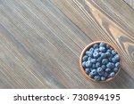 bowl of blueberries on the... | Shutterstock . vector #730894195