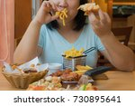 asian woman is eating french... | Shutterstock . vector #730895641