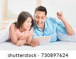 asian lovely couple relaxing... | Shutterstock . vector #730897624