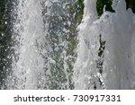 splashing water in the city...   Shutterstock . vector #730917331