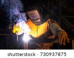 welder worker welding and... | Shutterstock . vector #730937875
