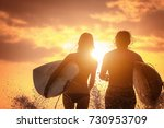 couple of surfers run with... | Shutterstock . vector #730953709