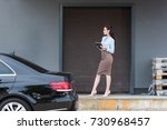 young attractive businesswoman... | Shutterstock . vector #730968457