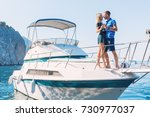 couple relaxing on a yacht at... | Shutterstock . vector #730977037