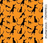 pattern with black cats on an... | Shutterstock .eps vector #730989811