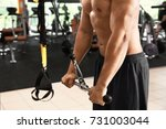 sporty young man training in gym   Shutterstock . vector #731003044