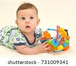 portrait of the surprised baby... | Shutterstock . vector #731009341