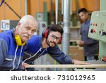 a carpenter and his trainee | Shutterstock . vector #731012965