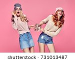 young woman surprised smiling....   Shutterstock . vector #731013487