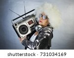 an amazing grandma dj  older... | Shutterstock . vector #731034169