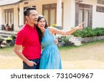 cheerful young couple looking... | Shutterstock . vector #731040967