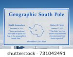Sign marking the Geographic South Pole.