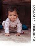 Small photo of Cute baby crawling with kajal eyes, Kathmadu, Bhaktapur, Nepal, October 09, 2013