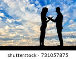 silhouette man and woman...   Shutterstock . vector #731057875