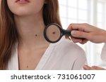 Doctor Dermatologist Examines...