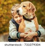 happy smiling boy hugs his best ...   Shutterstock . vector #731079304