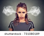 closeup portrait of angry young ... | Shutterstock . vector #731080189