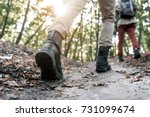 feet of young couple hiking in... | Shutterstock . vector #731099674