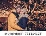 portrait of cute family hugging ... | Shutterstock . vector #731114125