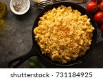 mac and cheese in a cast iron... | Shutterstock . vector #731184925