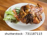 grilled chicken on wooden table. | Shutterstock . vector #731187115