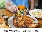 a man holding a fork is eating... | Shutterstock . vector #731187355