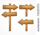 set of wooden arrow signs... | Shutterstock .eps vector #731207371