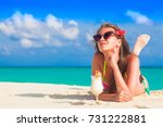 woman in bikini relaxing at... | Shutterstock . vector #731222881