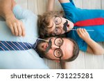 funny man and kid with fake... | Shutterstock . vector #731225281