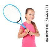Cute little girl with tennis...