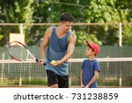 young trainer with little boy... | Shutterstock . vector #731238859