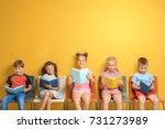 cute little children reading... | Shutterstock . vector #731273989