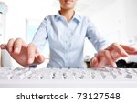 Photo of woman?s hands over keyboard in the office - stock photo