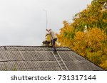 male chimney sweep cleans the... | Shutterstock . vector #731317144