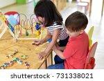child  having fun learning ...   Shutterstock . vector #731338021