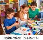 child dough play in school.... | Shutterstock . vector #731350747