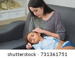 young mother checking... | Shutterstock . vector #731361751