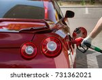 filling the red sport car with... | Shutterstock . vector #731362021