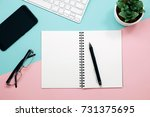 office desk table with notebook ... | Shutterstock . vector #731375695