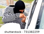 Small photo of robbery : Bandits, wearing black masks, using passkey to steal cars with skill