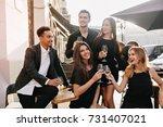 joyful brunette man in black... | Shutterstock . vector #731407021